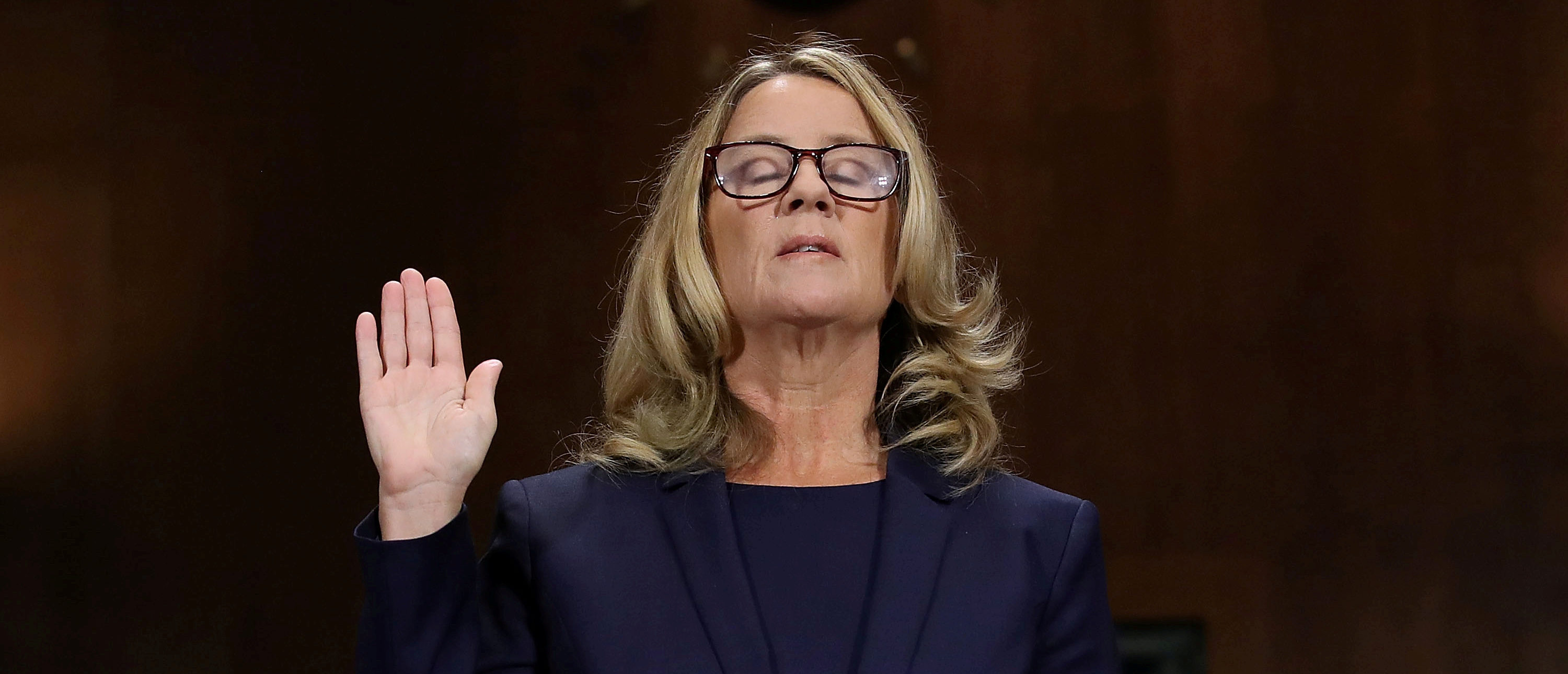 Christine Blasey Ford is sworn in before testifying the Senate Judiciary Committee in the Dirksen Senate Office Building at the Capitol Hill in Washington, D.C., September 27, 2018. Win McNamee/Pool via REUTERS
