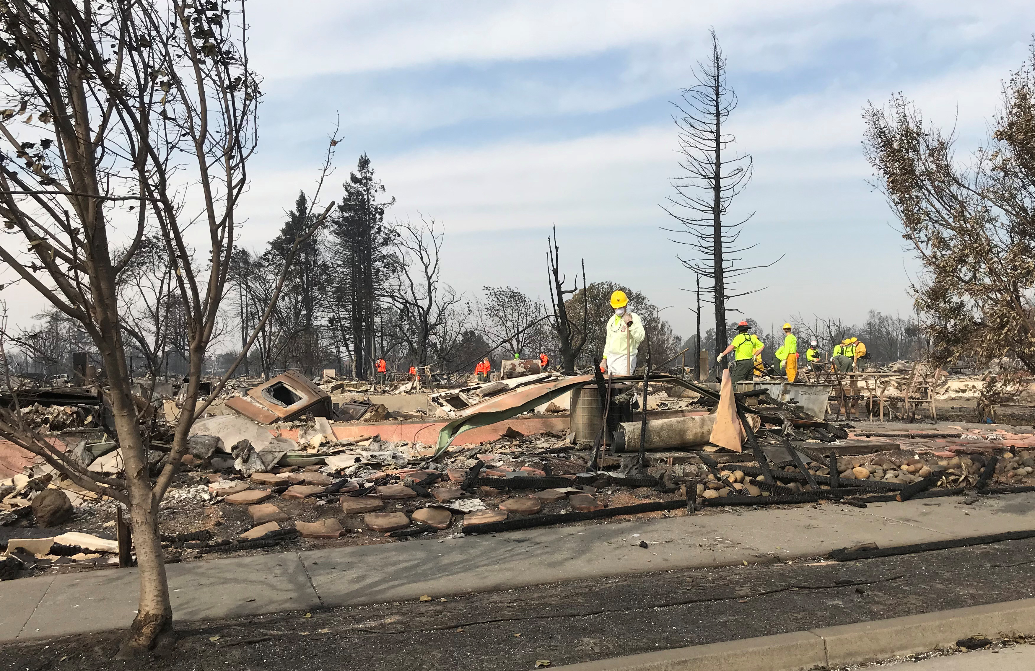 Search-and-rescue teams comb through the Coffey Park area looking for dozens of people still missing in the state's deadliest wildfires, in Santa Rosa, California