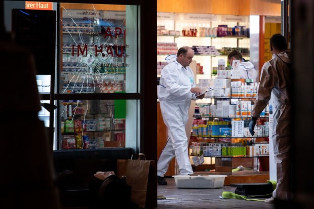 "Forensics of the police secure evidences in a pharmacy at the main railway station in Cologne, western Germany, on October 15, 2018, after a hostage drama. - A man who hurled a burning molotov cocktail in a McDonald's restaurant inside the station then took a woman hostage at the pharmacy may have acted with a ""terrorist"" motive, police said. MARIUS BECKER/AFP/Getty Images"