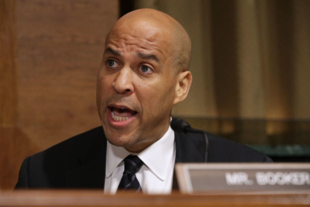 WASHINGTON, DC - SEPTEMBER 28: Senate Judiciary Committee member Sen. Cory Booker (D-NJ) delivers remarks about Supreme Court nominee Judge Brett Kavanaugh during a mark up hearing in the Dirksen Senate Office Building on Capitol Hill September 28, 2018 in Washington, DC. (Photo by Chip Somodevilla/Getty Images)