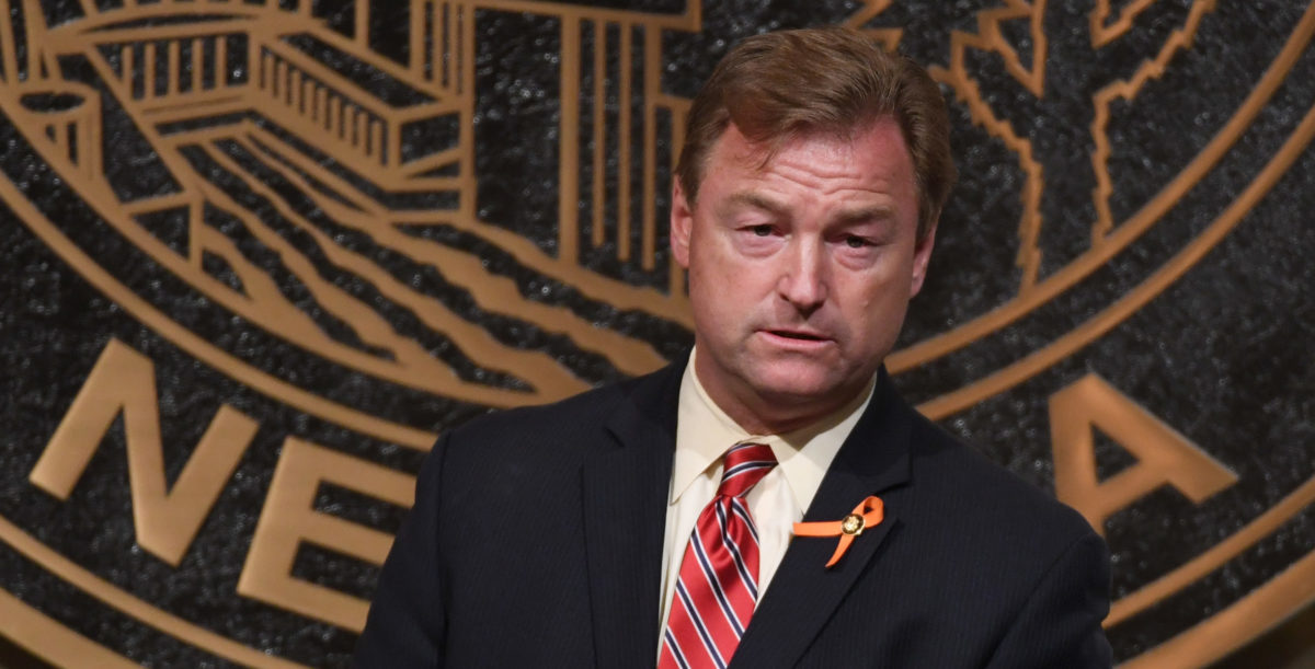 LAS VEGAS, NV - OCTOBER 07: U.S. Sen. Dean Heller (R-NV) speaks at the culmination of a faith unity walk, held to help the community heal after Sunday's mass shooting, at Las Vegas City Hall on October 7, 2017 in Las Vegas, Nevada. On October 1, Stephen Paddock killed at least 58 people and injured more than 450 after he opened fire on a large crowd at the Route 91 Harvest country music festival. The massacre is one of the deadliest mass shooting events in U.S. history. (Photo by Ethan Miller/Getty Images)