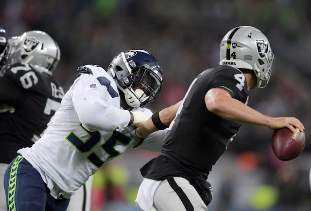 Oct 14, 2018; London, United Kingdom; Oakland Raiders quarterback Derek Carr (4) is pressured by Seattle Seahawks defensive end Frank Clark (55) in the first half during an NFL International Series game at Wembley Stadium. Mandatory Credit: Kirby Lee-USA TODAY Sports (Photo: Reuters Images)