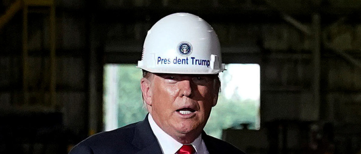 U.S. President Donald Trump wears a hard hat as he tours the Granite City Works hot strip steel mill in Granite City, Illinois, U.S., July 26, 2018. REUTERS/Joshua Roberts