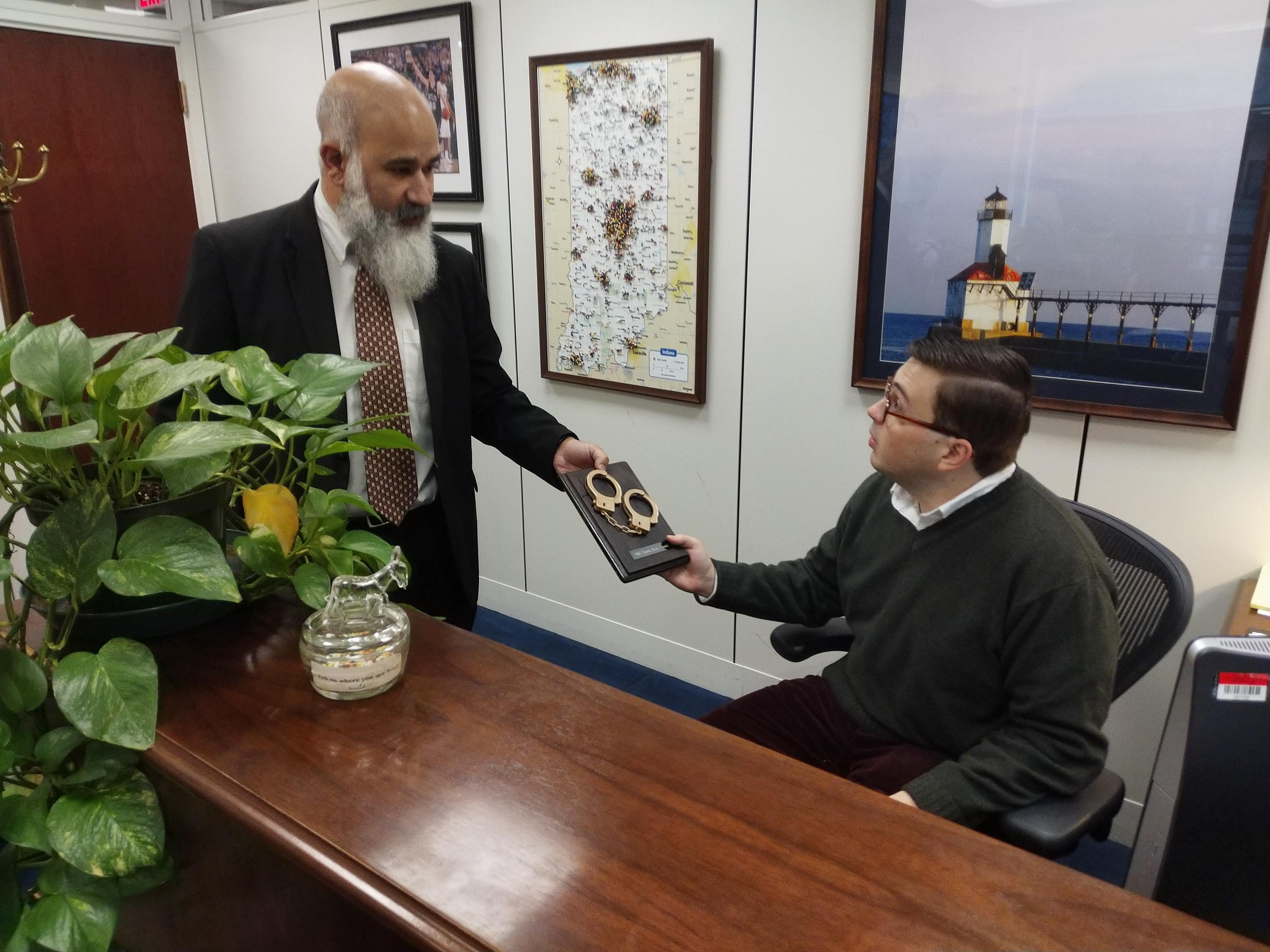 National Right-to-Work Committee vice president Greg Mourad delivers a 2018 Union Brass Award to the office of Democrat Sen. Joe Donnelly of Indiana.