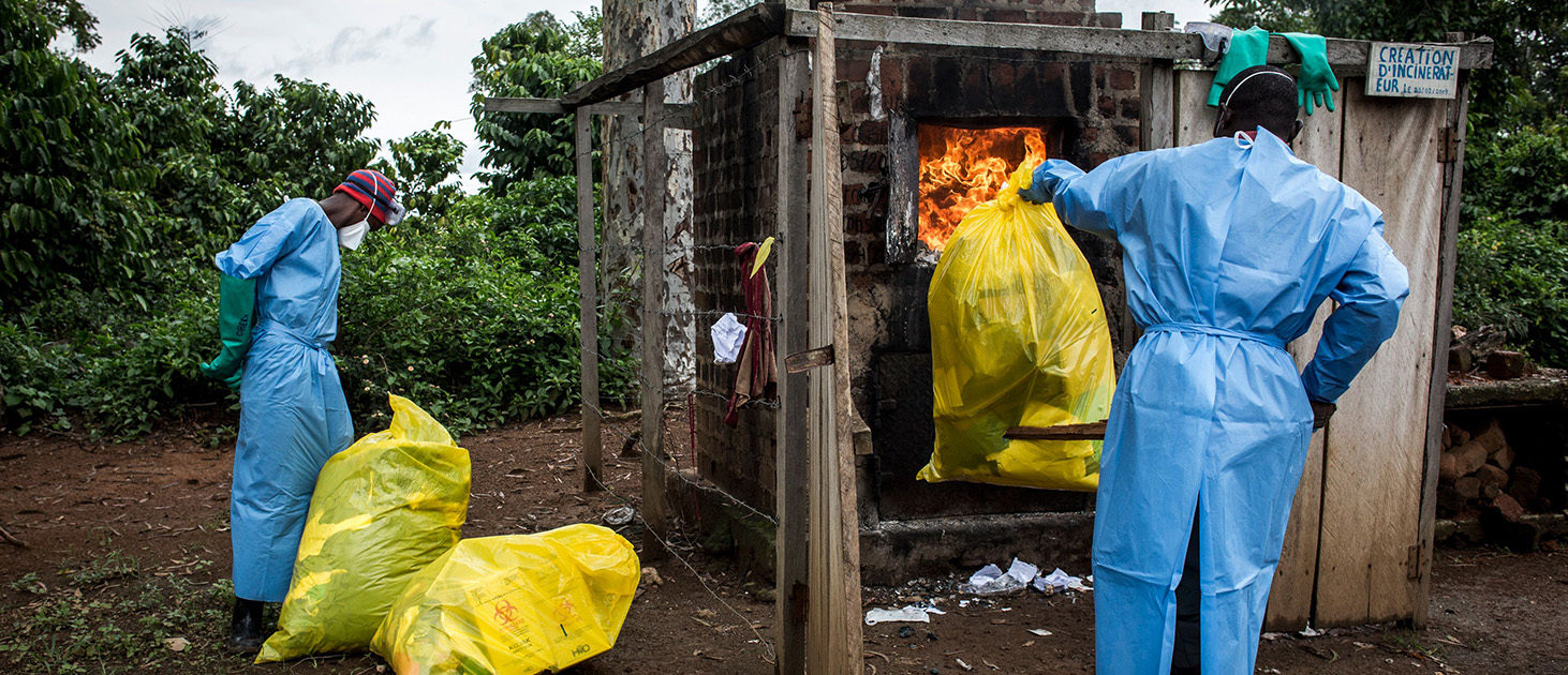 Health workers burn medical waste generated during care of patients with Ebola virus, on August 21, 2018 in Mangina, near Beni, in the North Kivu province. - Sixty-one people have died in the latest outbreak of Ebola in the Democratic Republic of Congo (DRC), the authorities said, adding that four novel drugs had been added to the roster of treatments. The outbreak began on August 1 in Mangina, the epicentre of the outbreak in the North Kivu province, and cases have been reported in neighbouring Ituri province. It is the 10th outbreak to strike the DRC since 1976, when Ebola was first identified and named after a river in the north of the country. JOHN WESSELS/AFP/Getty Images