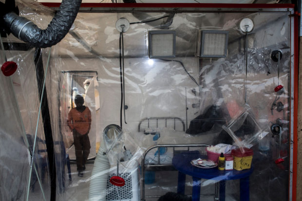 An unconfirmed Ebola patient enters a Biosecure Emergency care Unite (CUBE) in the new Ebola Treatment Centre (ETC) on August 15, 2018 in Beni. - The new ETC will hold ten Biosecure Emergency care Unite (CUBEs), which will be used for the first time to treat Ebola patients and are currently being constructed by (ALIMA) The Alliance for International Medical Action in response to the ebola outbreak. (Photo by John WESSELS / AFP) (Photo credit should read JOHN WESSELS/AFP/Getty Images)