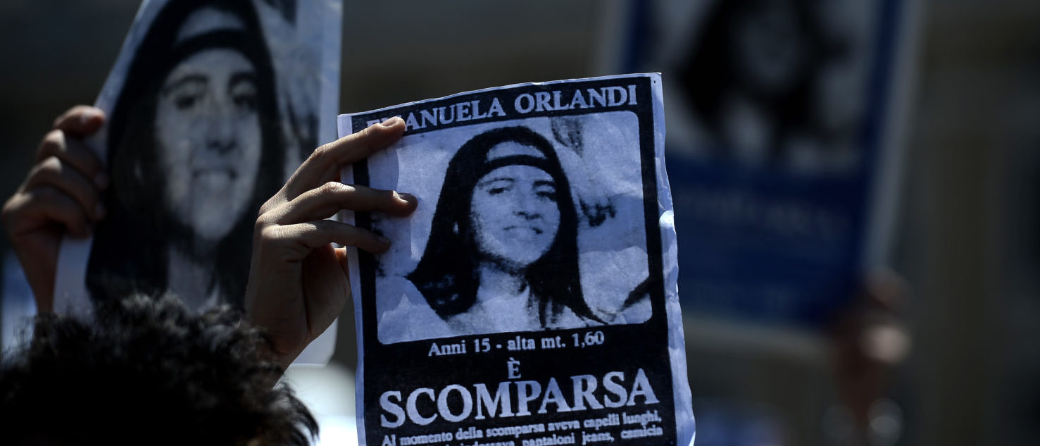 """A demonstrator holds a poster of Emanuela Orlandi reading """"Missing"""" during Pope Benedict XVI's Regina Coeli noon prayer in St. Peter's square, at the Vatican on May 27, 2012. Fifteen-year-old Emanuela Orlandi, the daughter of a Vatican messenger who lived with his family in Vatican City, disappeared 25 years ago (June 22, 1983) when she went to a music lesson. AFP PHOTO/ FILIPPO MONTEFORTE /Getty"""