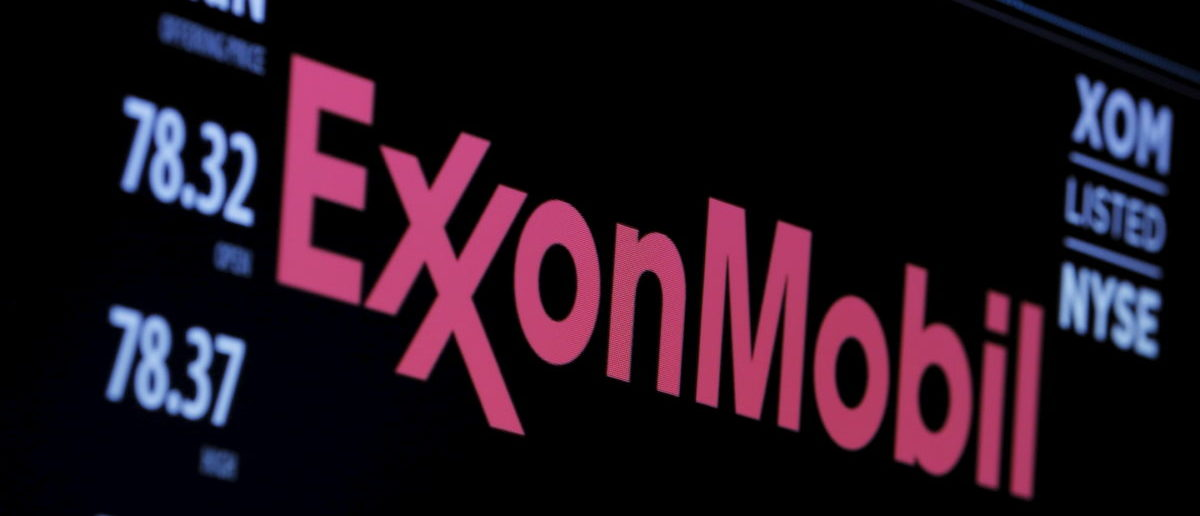 The logo of Exxon Mobil Corporation is shown on a monitor above the floor of the New York Stock Exchange in New York, December 30, 2015. REUTERS/Lucas Jackson