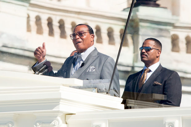 "WASHINGTON, DC - OCTOBER 10, 2105: Minister Louis Farrakhan speaks from behind a bullet-proof shield on the West Front of the U.S. Capitol building for ""Justice or Else,"" a rally held to commemorate the 20th anniversary of the Million Man March on October 10, 2015 in Washington, D.C. The rally organized by Nation of Islam leader Louis Farrakhan incuded speakers from the 1995 rally and current civil rights leaders. (Photo by Allison Shelley/Getty Images)"