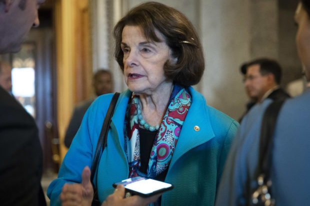 WASHINGTON, DC - OCTOBER 6: Sen. Dianne Feinstein (D-CA) talks to reporters as she exits the Senate floor following the Senate's confirmation of the nomination of Judge Brett Kavanaugh to the U.S. Supreme Court, October 6, 2018 in Washington, DC. (Drew Angerer/Getty Images)