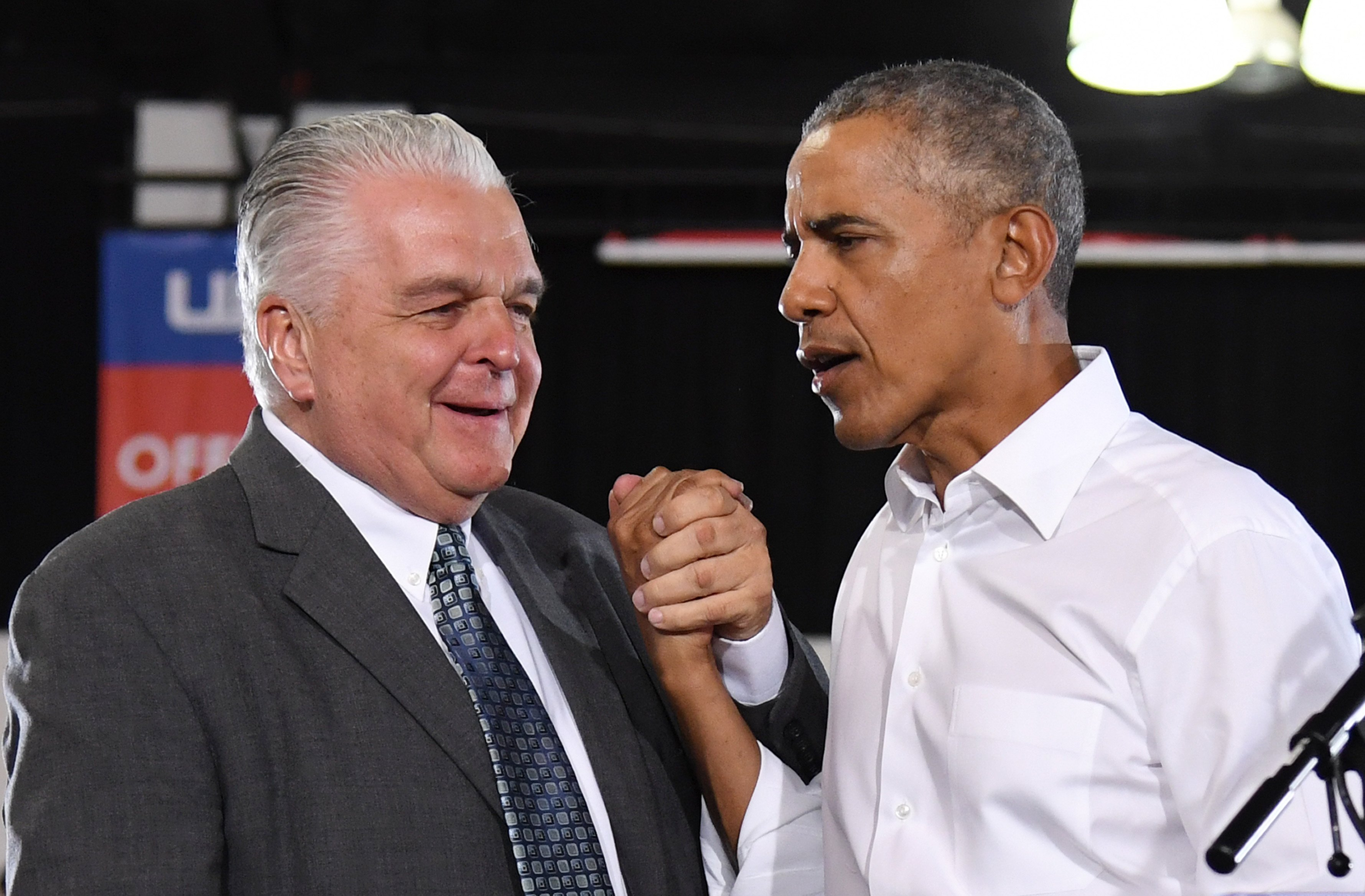 LAS VEGAS, NEVADA - OCTOBER 22: Clark County Commission Chairman and Democratic gubernatorial candidate Steve Sisolak (L) shakes hands with former U.S. President Barack Obama after they spoke at a get-out-the-vote rally at the Cox Pavilion as Obama campaigns for Nevada Democratic candidates on October 22, 2018 in Las Vegas, Nevada. (Photo by Ethan Miller/Getty Images)