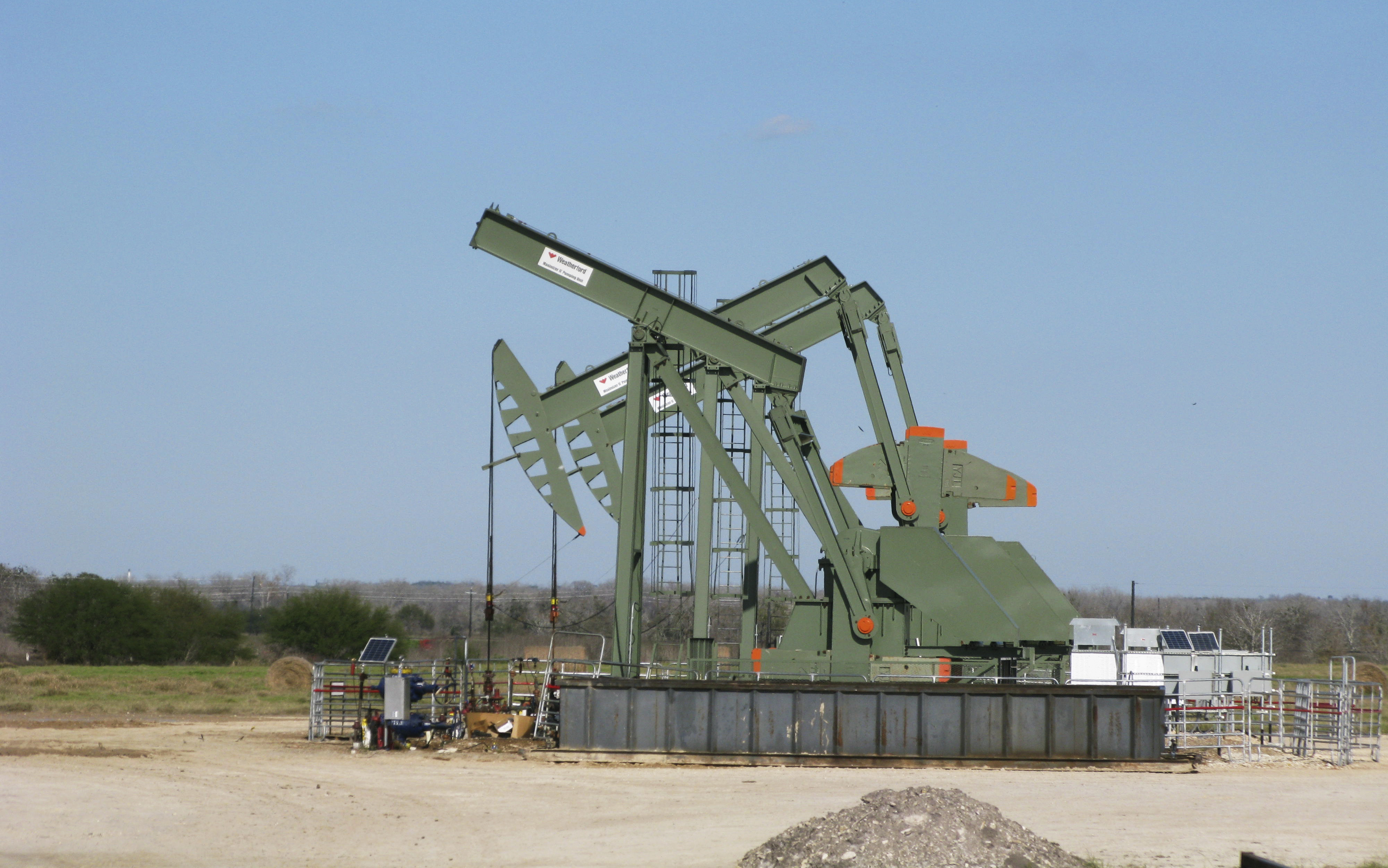 A pump jack used to help lift crude oil from a well in South Texas? Eagle Ford Shale formation stands idle in Dewitt County Texas