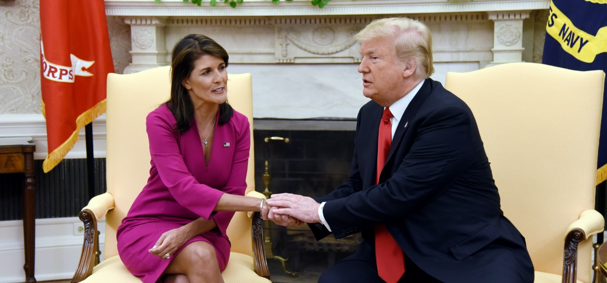 """US President Donald Trump shakes hands with Nikki Haley, the United States Ambassador to the United Nations in the Oval office of the White House on October 9, 2018 in Washington, DC. - Nikki Haley resigned Tuesday as the US ambassador to the United Nations, in the latest departure from President Donald Trump's national security team. Meeting Haley in the Oval Office, Trump said that Haley had done a """"fantastic job"""" and would leave at the end of the year. (Photo: OLIVIER DOULIERY/AFP/Getty Images)"""
