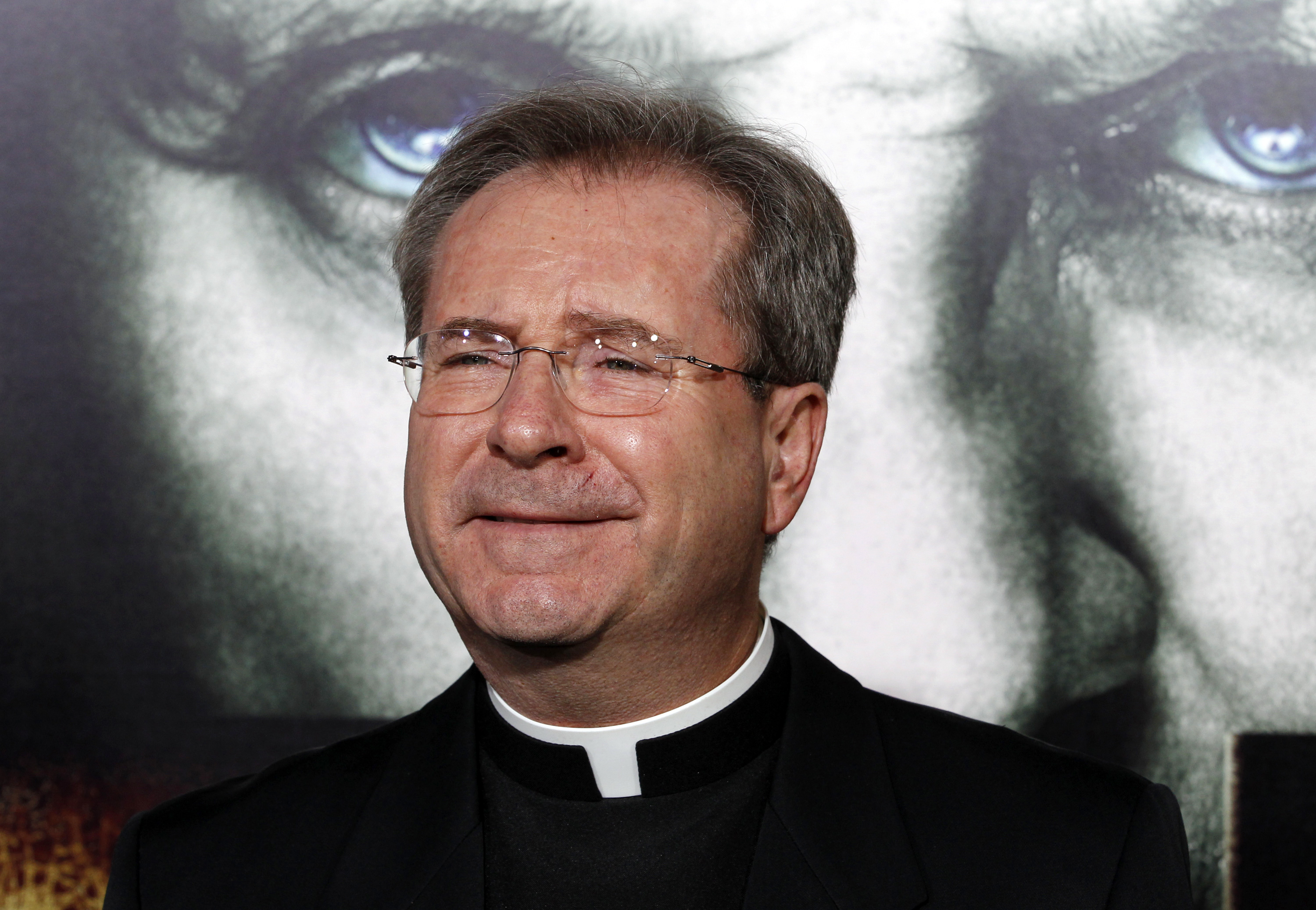"Father Gary Thomas of Sacred Heart Parish in Saratoga, California, a Vatican-trained exorcist and advisor on the film ""The Rite"", poses at the film's premiere in Hollywood, California January 26, 2011. REUTERS/Fred Prouser"