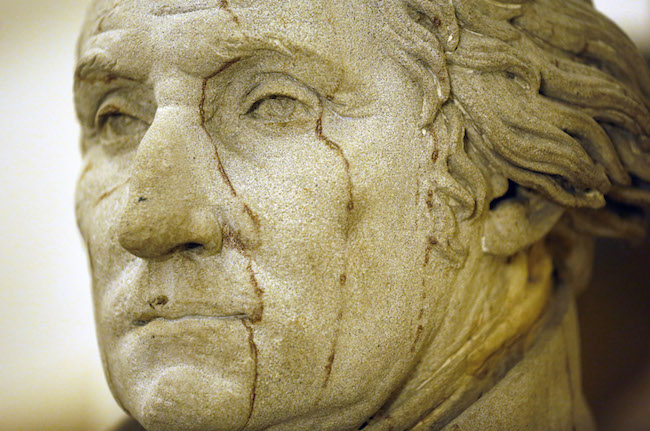 A statue of George Washington, the first president of the United States, is seen near the office of U.S. Speaker of the House John Boehner in the U.S. Capitol building in Washington October 1, 2013. REUTERS/Jim Bourg