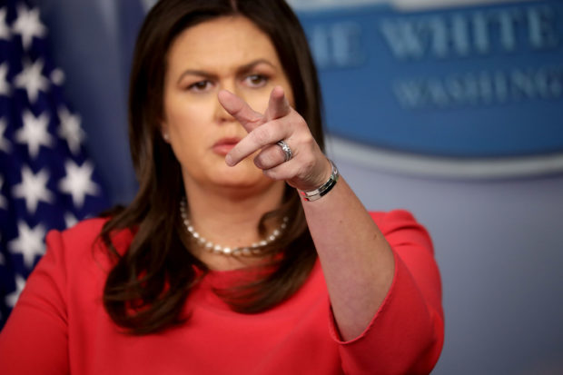 WASHINGTON, DC - JULY 18: White House Press Secretary Sarah Huckabee Sanders calls on reporters during a news conference in the Brady Press Briefing Room at the White House July 18, 2018 in Washington, DC. During the press conference Sanders said that Russian meddling didn't happen under President Donald Trump's watch but under the Obama administration. (Photo by Chip Somodevilla/Getty Images)