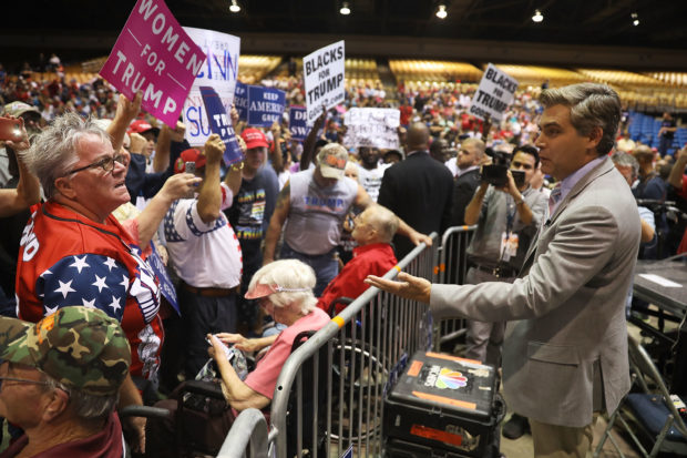 TAMPA, FL - JULY 31: CNN reporter Jim Acosta (R) speaks to people before the arrival of President Donald Trump for his Make America Great Again Rally at the Florida State Fair Grounds Expo Hall on July 31, 2018 in Tampa, Florida. Before the rally, President Trump was scheduled to visit the Tampa Bay Technical High School for a roundtable discussion on Workforce Development in Tampa. (Photo by Joe Raedle/Getty Images)