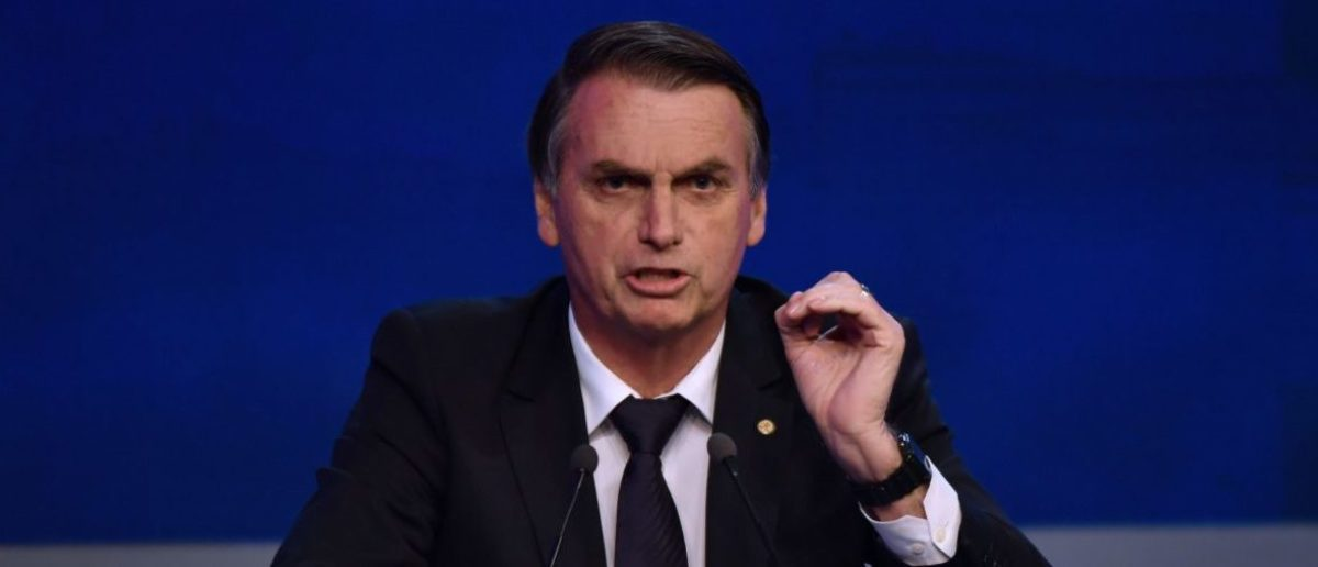 Brazilian presidential candidate Jair Bolsonaro (PSL), speaks during the first presidential debate ahead of the October 7 general election, at Bandeirantes television network in Sao Paulo, Brazil, on August 9, 2018. (Photo by Nelson ALMEIDA / AFP) (Photo credit should read NELSON ALMEIDA/AFP/Getty Images)