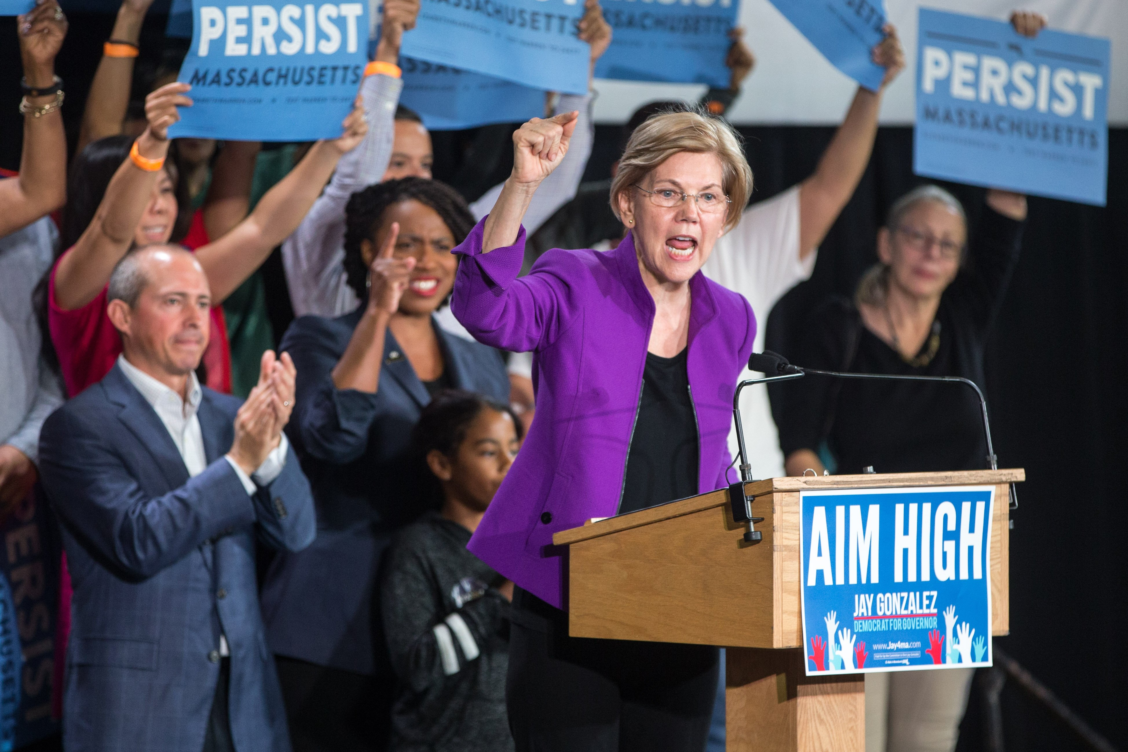 CAMBRIDGE, MA - SEPTEMBER 09: U.S. Sen. Elizabeth Warren speaks at a rally held for Democratic gubernatorial candidate Jay Gonzalez (L) and congressional Democratic candidate Ayanna Pressley (2nd L) on September 9, 2018 in Cambridge, Massachusetts. (Photo by Scott Eisen/Getty Images)