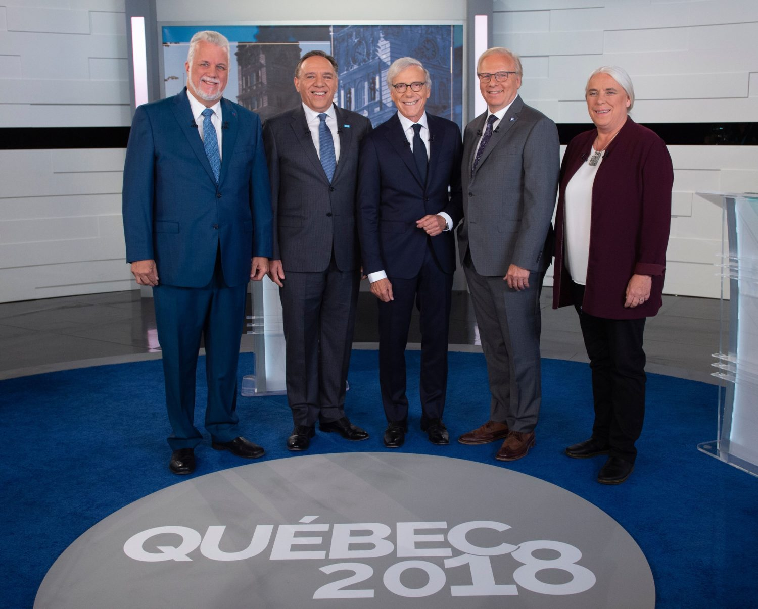 (L-R) Minister and Liberal party leader Philippe Couillard, coalition Avenir Quebec party leader Francois Legault, journalist and news anchor Pierre Bruneau, Quebecers Party leader Jean-Fracois Lisse and member of Quebec Solidary party Manon Masse, pose for pictures before a debate prior to Quebec's local elections, in Quebec, Canada on September 20, 2018. (SEBASTIEN ST-JEAN/AFP/Getty Images)