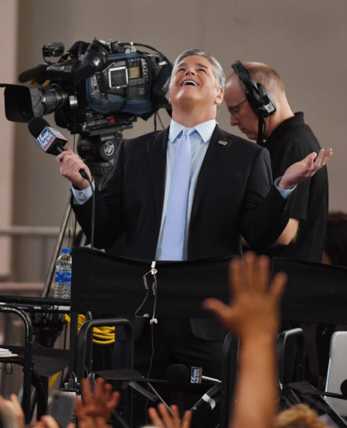 LAS VEGAS, NV - SEPTEMBER 20: Fox News Channel and radio talk show host Sean Hannity reacts to attendees before a Donald Trump campaign rally at the Las Vegas Convention Center on September 20, 2018 in Las Vegas, Nevada. Trump is in town to support the re-election campaign for U.S. Sen. Dean Heller (R-NV) as well as Nevada Attorney General and Republican gubernatorial candidate Adam Laxalt and candidate for Nevada's 3rd House District Danny Tarkanian and 4th House District Cresent Hardy. (Photo by Ethan Miller/Getty Images)