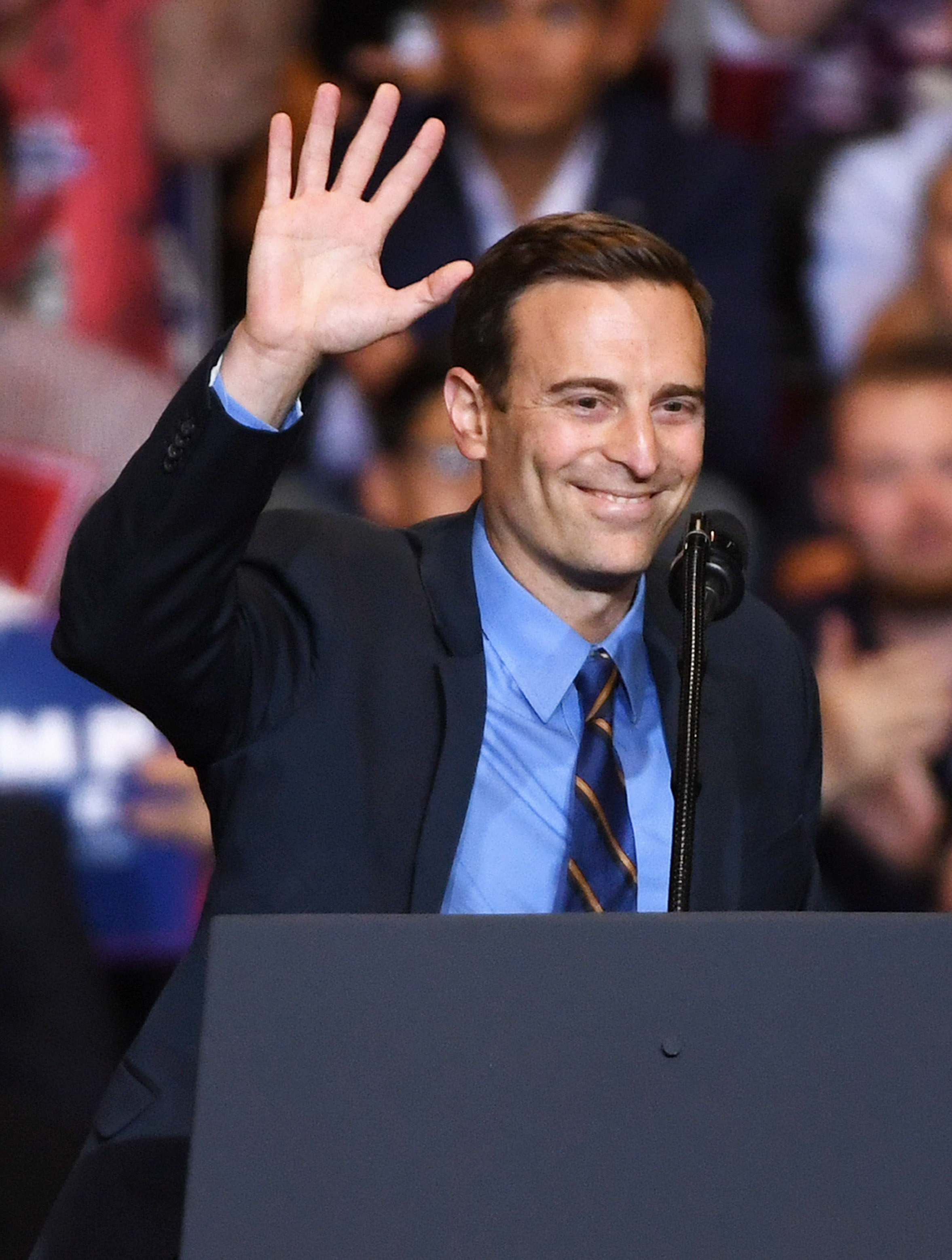 Nevada Attorney General and Republican gubernatorial candidate Adam Laxalt waves after speaking during a Donald Trump campaign rally at the Las Vegas Convention Center on September 20, 2018 in Las Vegas, Nevada. Ethan Miller/Getty Images
