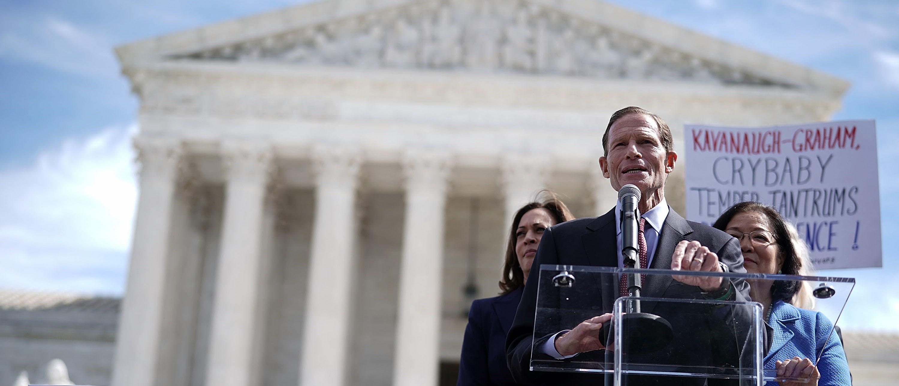 WASHINGTON, DC - SEPTEMBER 28: Sen. Richard Blumenthal (D-CT) (2nd L) speaks as Sen. Mazie Hirono (D-HI) (R) and Sen. Kamala Harris (D-CA) (L) listen during a rally in front of the U.S. Supreme Court September 28, 2018 in Washington, DC. Activists staged a rally to call to drop the nomination of Judge Brett Kavanaugh to the U.S. Supreme Court. (Photo by Alex Wong/Getty Images)