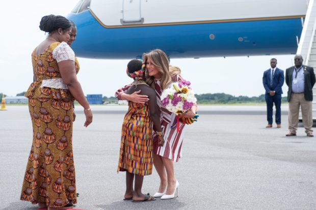 US First Lady Melania Trump receives flowers during an arrival ceremony after landing at Kotoka International Airport in Accra October 2, 2018 as she begins her week long trip to Africa to promote her 'Be Best' campaign. (Photo by SAUL LOEB / AFP) (Photo credit should read SAUL LOEB/AFP/Getty Images)