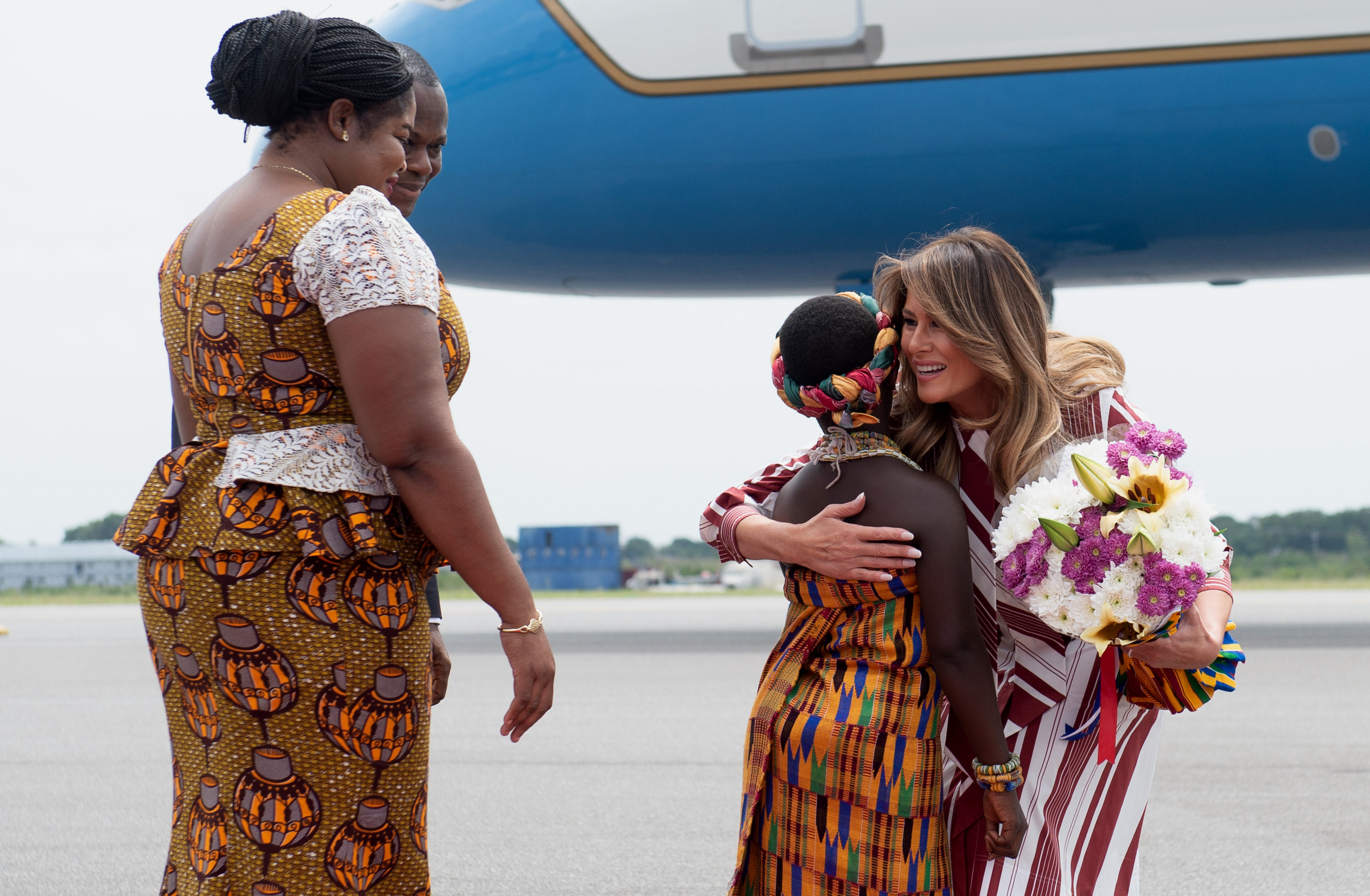 First lady Melania Trump receives flowers during an arrival ceremony after landing at Kotoka International Airport in Accra October 2, 2018 as she begins her week long trip to Africa to promote her 'Be Best' campaign. (Photo: SAUL LOEB/AFP/Getty Images)