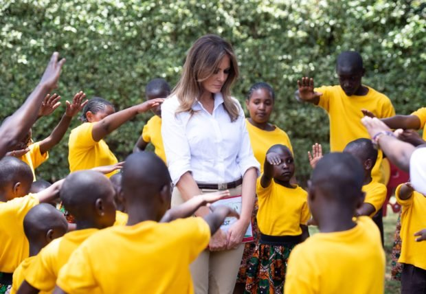 TOPSHOT - Children pray for US First Lady Melania Trump as she visits the Nest childrens home orphanage, which primarily cares for children who's parents have been incarcerated, in Nairobi, on October 5, 2018. - Melania Trump is in Africa to promote her children's welfare programme. (Photo by SAUL LOEB / AFP) (Photo credit should read SAUL LOEB/AFP/Getty Images)
