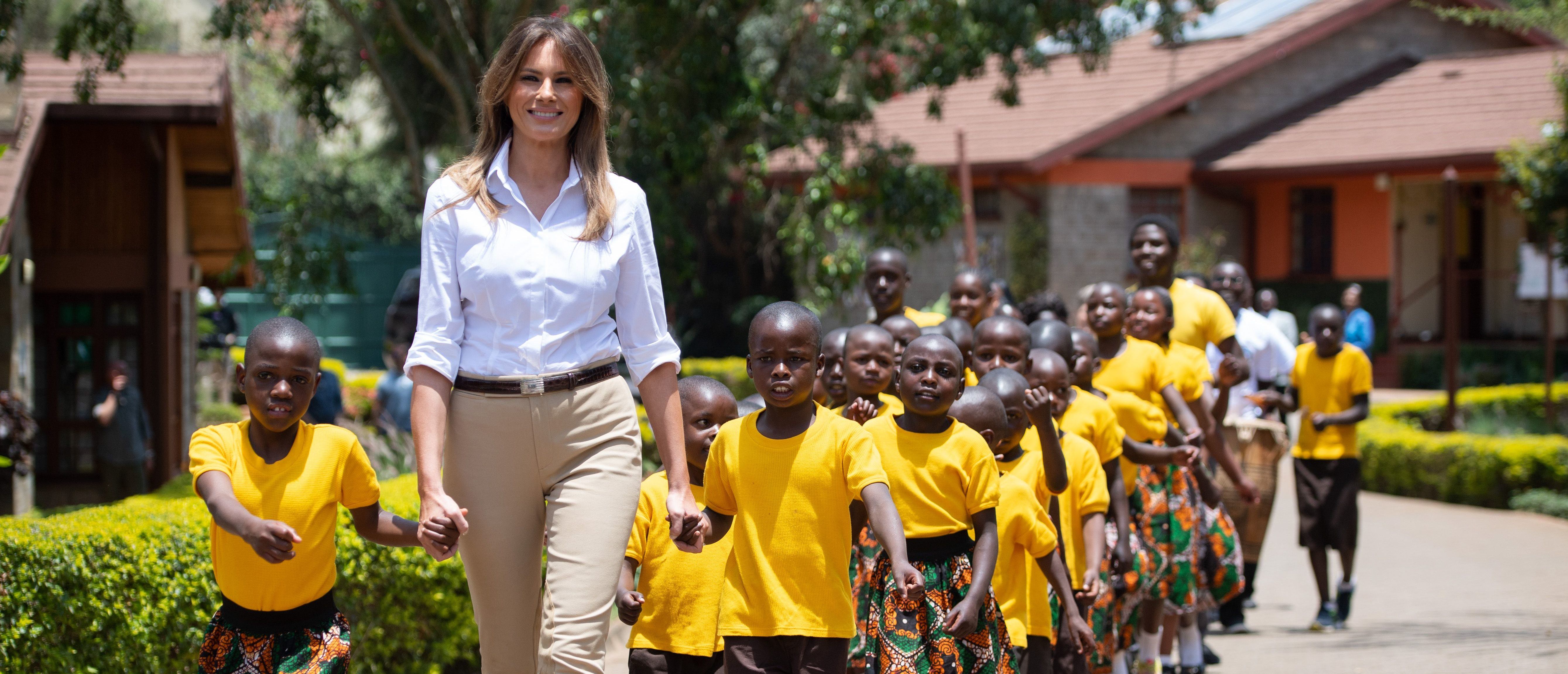 TOPSHOT - US First Lady Melania Trump walks and sings with children as she visits the Nest Childrens Home Orphanage in Nairobi, on October 5, 2018, which primarily cares for children whose parents have been incarcerated. (Photo by SAUL LOEB / AFP) (Photo credit should read SAUL LOEB/AFP/Getty Images)