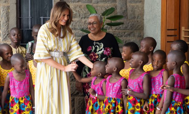 US First Lady Melania Trump (L) and Kenya's First Lady Margaret Kenyatta greet children as they arrive to attend a performance at the Kenyan National Theater in Nairobi, on October 5, 2018. (Photo by SAUL LOEB / AFP) (Photo credit should read SAUL LOEB/AFP/Getty Images)