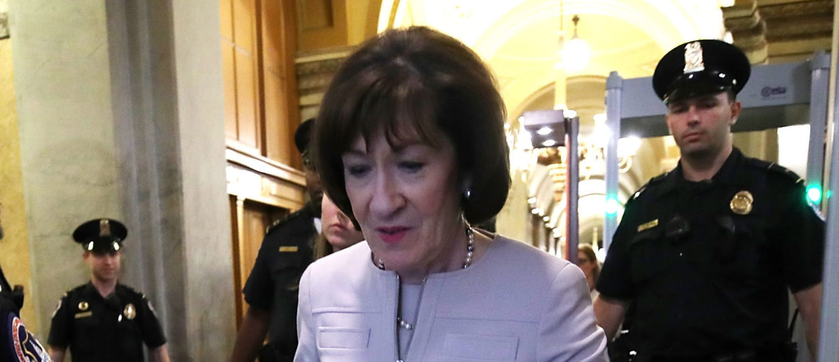 Sen. Susan Collins (R-ME) walks out of the carriage entrance of the U.S. Capitol after announcing that she would vote yes on the nomination of Supreme Court Judge Brett Kavanaugh to the U.S. Supreme Court, at the U.S. Capitol, October 5, 2018 in Washington, DC. Photo by Mark Wilson/Getty Images