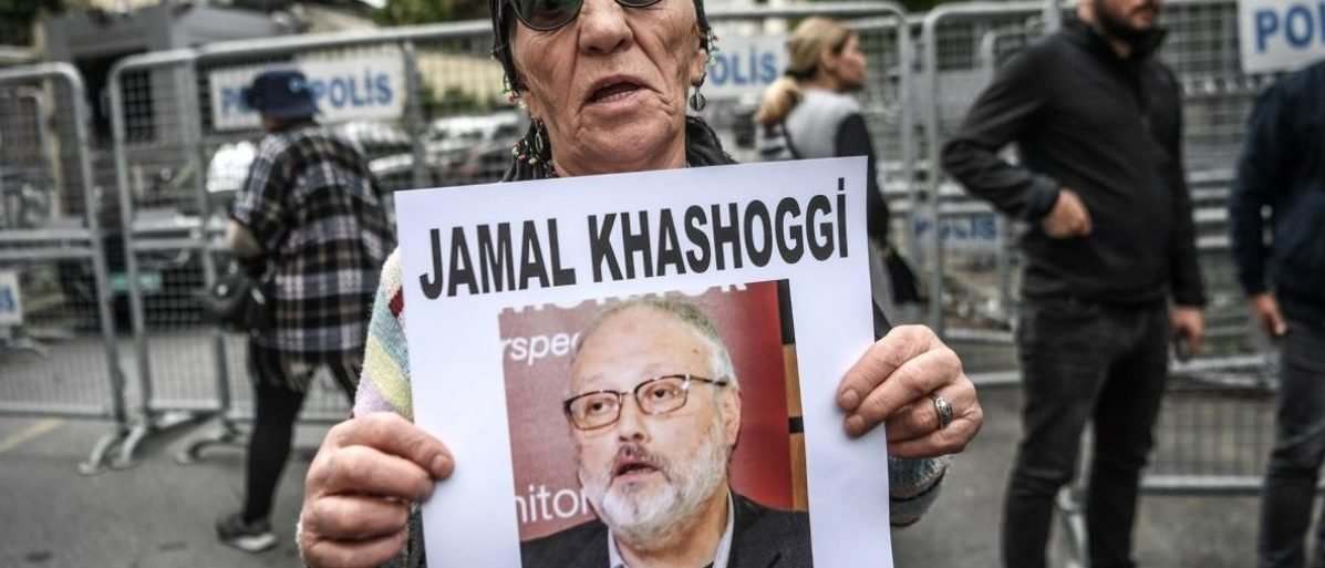 """A woman holds a portrait of missing journalist and Riyadh critic Jamal Khashoggi reading """"Jamal Khashoggi is missing since October 2"""" during a demonstration in front of the Saudi Arabian consulate on October 9, 2018 in Istanbul. - Khashoggi, a Washington Post contributor, vanished last on October 2 after entering the Saudi Arabian consulate to receive official documents ahead of his marriage to a Turkish woman. A Turkish government source told AFP at the weekend that the police believe the journalist """"was killed by a team especially sent to Istanbul and who left the same day"""". (Photo by OZAN KOSE / AFP) (Photo credit should read OZAN KOSE/AFP/Getty Images)"""