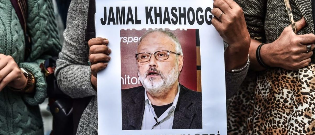 "A woman holds a portrait of missing journalist and Riyadh critic Jamal Khashoggi reading ""Jamal Khashoggi is missing since October 2"" during a demonstration in front of the Saudi Arabian consulate on October 9, 2018 in Istanbul. - Khashoggi, a Washington Post contributor, vanished last on October 2 after entering the Saudi Arabian consulate to receive official documents ahead of his marriage to a Turkish woman. A Turkish government source told AFP at the weekend that the police believe the journalist ""was killed by a team especially sent to Istanbul and who left the same day"". (Photo by OZAN KOSE / AFP) (Photo credit should read OZAN KOSE/AFP/Getty Images)"