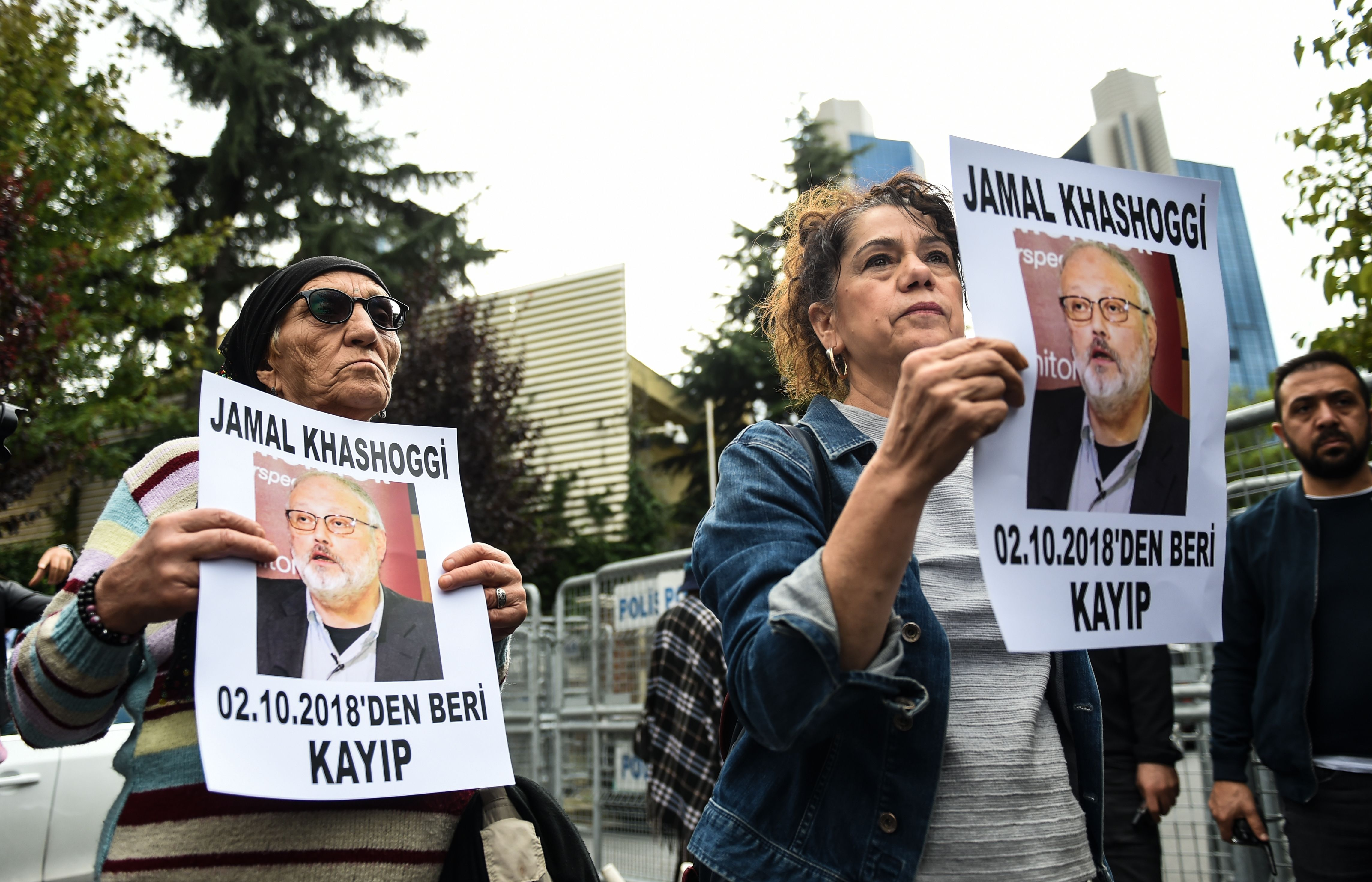 "Members of Human Rights Association (IHD) hold portraits of missing journalist Jamal Khashoggi reading ""Jamal Khashoggi is missing since October 2"" during a demonstration outside Saudi Arabia's consulate in Istanbul on October 9, 2018. KILIC/AFP/Getty Images"