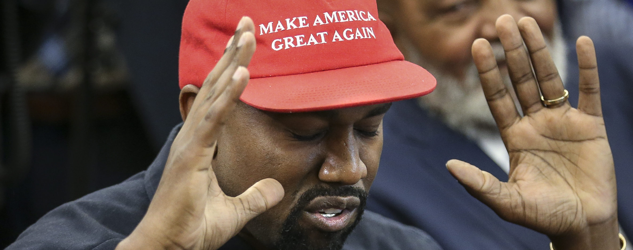 WASHINGTON, DC - OCTOBER 11: (AFP OUT) Rapper Kanye West speaks during a meeting with U.S. President Donald Trump in the Oval office of the White House on October 11, 2018 in Washington, DC. (Photo by Oliver Contreras - Pool/Getty Images)