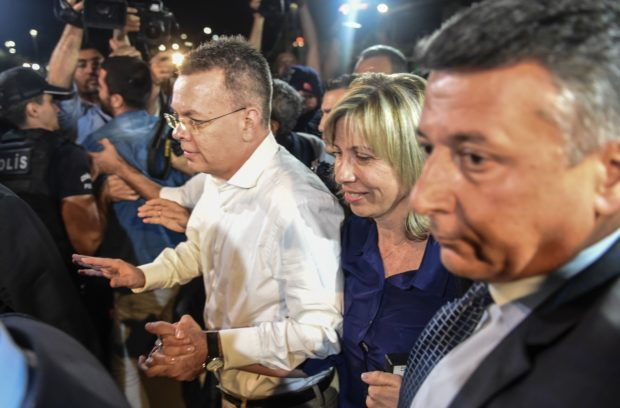 US pastor Andrew Craig Brunson (C,L) arrives at Adnan Menderes airport in Izmir, on October 12, 2018 after being freed following a trial in a court in Aliaga in western Izmir province. - US pastor Andrew Brunson, freed after a two-year detention in Turkey that shook relations between the countries, said on October 12 he was heading home soon. (Photo by BULENT KILIC / AFP) (Photo credit should read BULENT KILIC/AFP/Getty Images)
