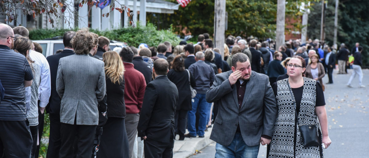 Mourners grieve after leaving a service at St. Stanislaus Roman Catholic Church for some of the victims in last weekend's fatal limo crash on October 12, 2018 in Amsterdam, New York. Photo by Stephanie Keith/Getty Images