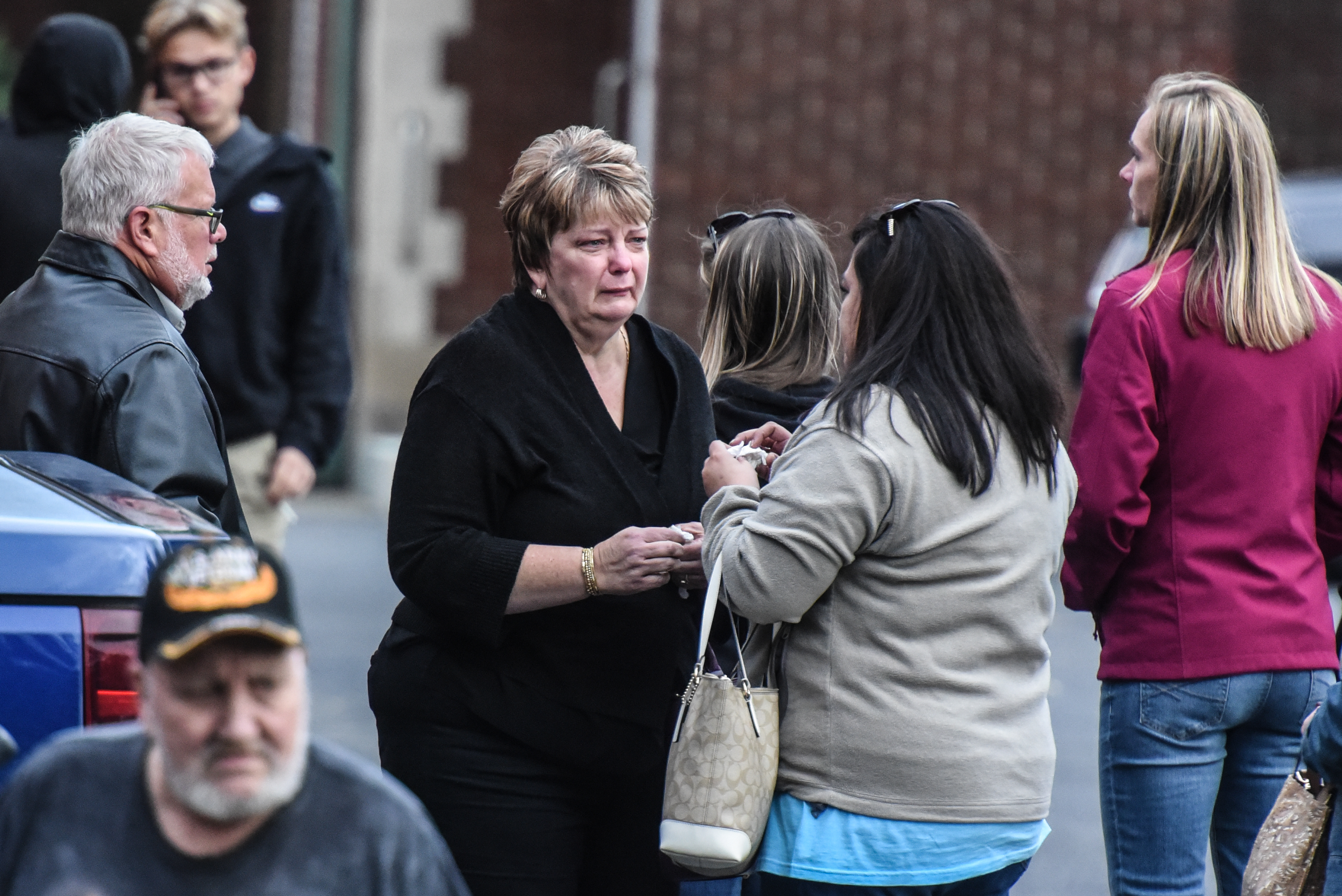 Mourners grieve after leaving a service at St. Stanislaus Roman Catholic Church for some of the victims in last weekend's fatal limo crash on October 12, 2018 in Amsterdam, New York. 20 people died in the crash including the driver of the limousine, 17 passengers, and two pedestrians. Photo by Stephanie Keith/Getty Images