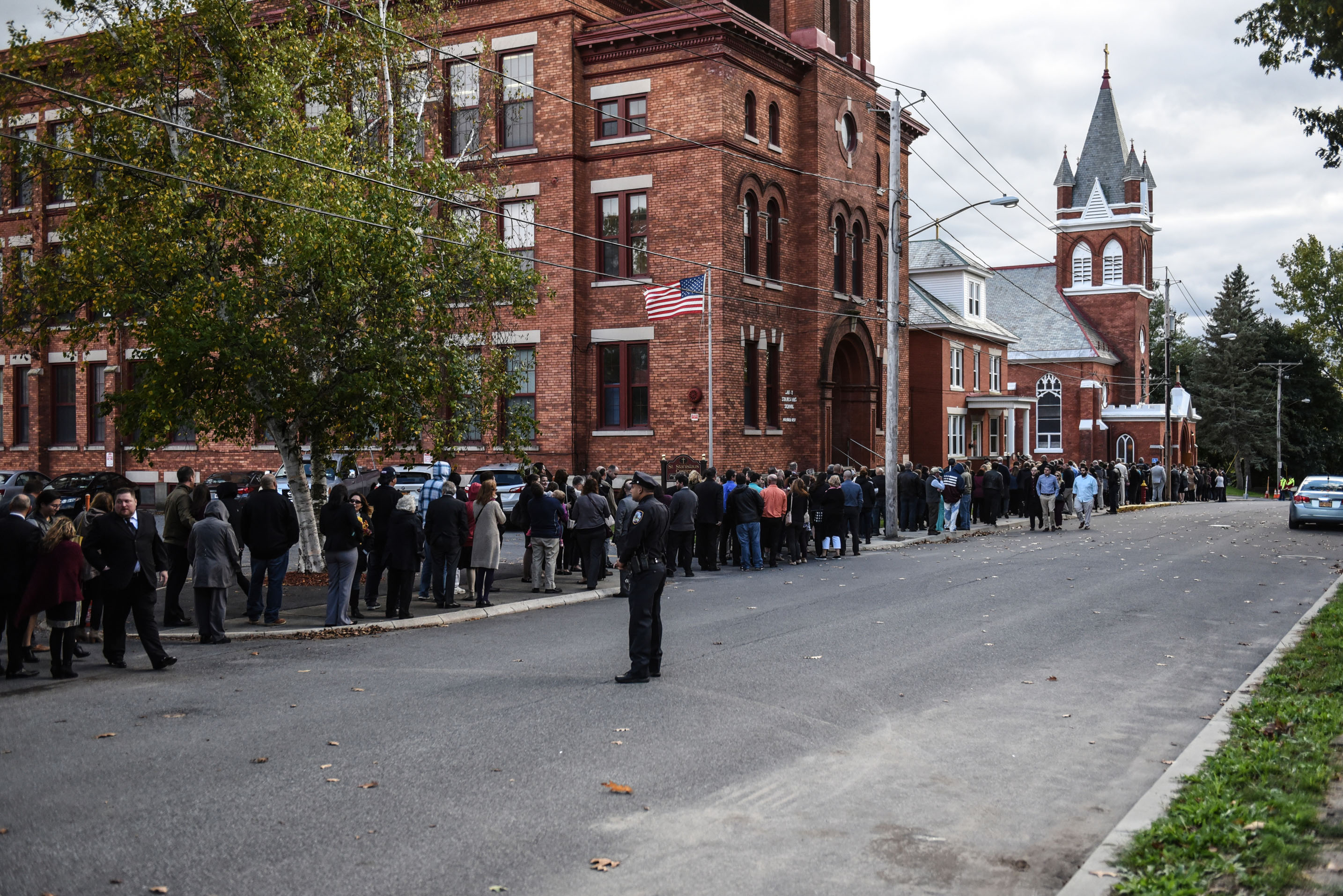 Mourners line up in front of St. Stanislaus Roman Catholic Church to pay their respects to some of the victims in last weekend's fatal limo crash on October 12, 2018 in Amsterdam, New York. Photo by Stephanie Keith/Getty Images