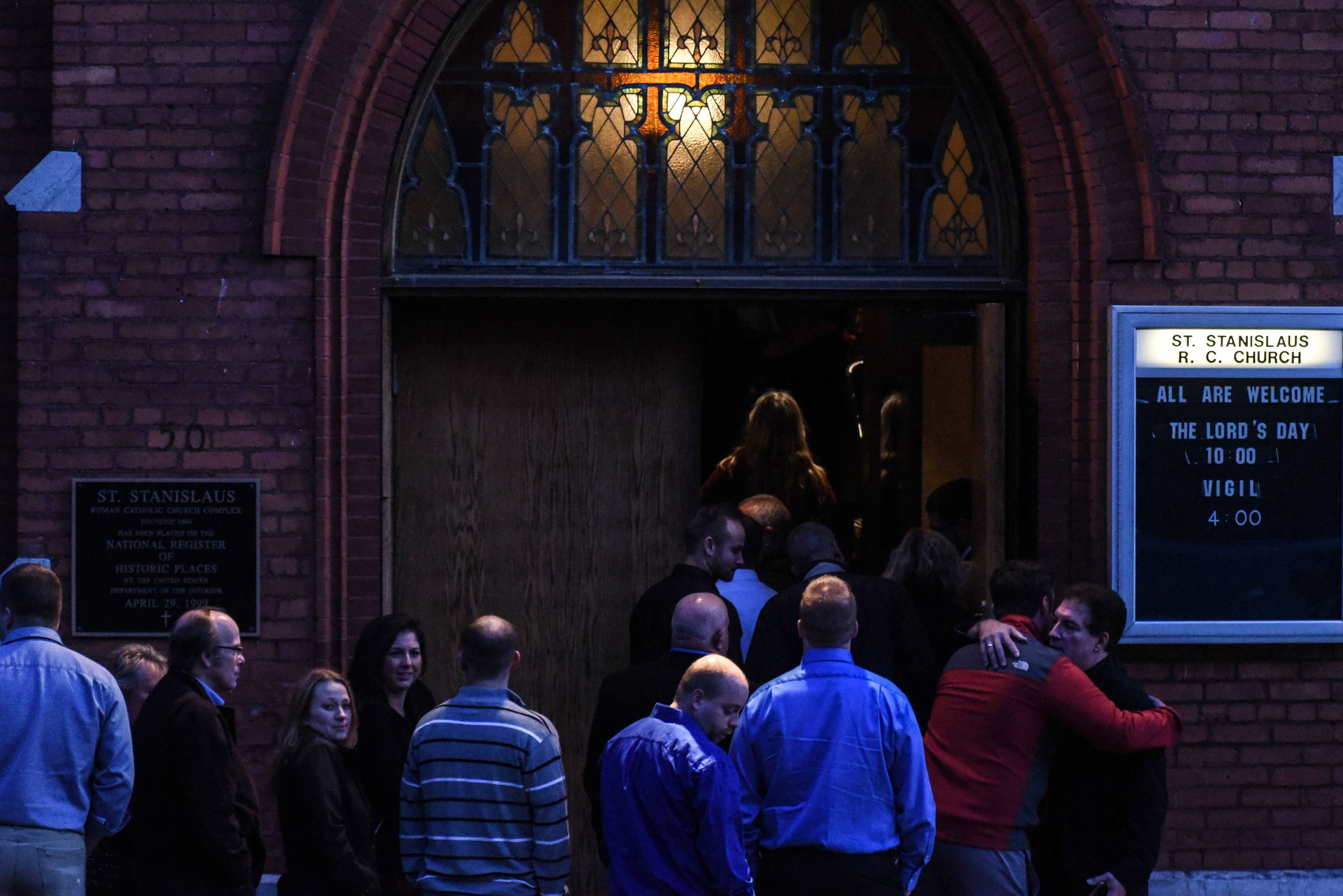 Mourners line up in front of St. Stanislaus Roman Catholic Church to pay their respects to some of the victims in last weekend's fatal limo crash on October 12, 2018 in Amsterdam, New York. 20 people died in the crash including the driver of the limousine, 17 passengers, and two pedestrians. Photo by Stephanie Keith/Getty Images