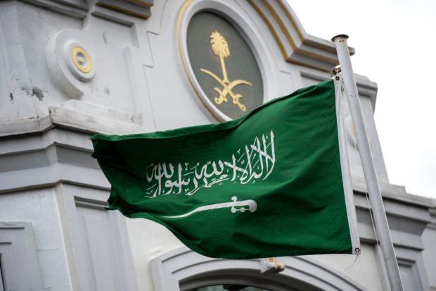 """A Saudi Arabia flag flies in front of the Saudi consulate in Istanbul on October 13, 2018. - Saudi Arabia dismissed on Octiber 13 accusations that Jamal Khashoggi was ordered murdered by a hit squad inside its Istanbul consulate as """"lies and baseless allegations"""", as Riyadh and Ankara spar over the missing journalist's fate. (Photo by Yasin AKGUL / AFP) (Photo credit should read YASIN AKGUL/AFP/Getty Images)"""