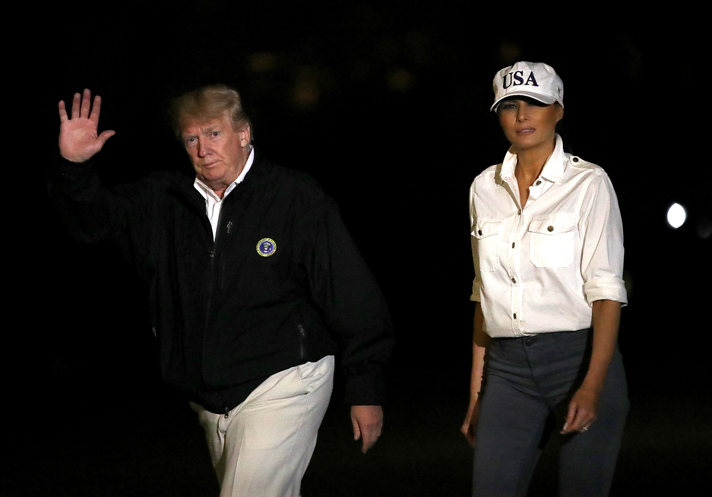 WASHINGTON, DC - OCTOBER 15: U.S. President Donald Trump (L) and first lady Melania Trump (R) return to the White House from Florida and Georgia on October 15, 2018 in Washington, DC. U.S. President Donald Trump visited areas in Florida and Georgia that were affected by Hurricane Michael. (Photo by Justin Sullivan/Getty Images)
