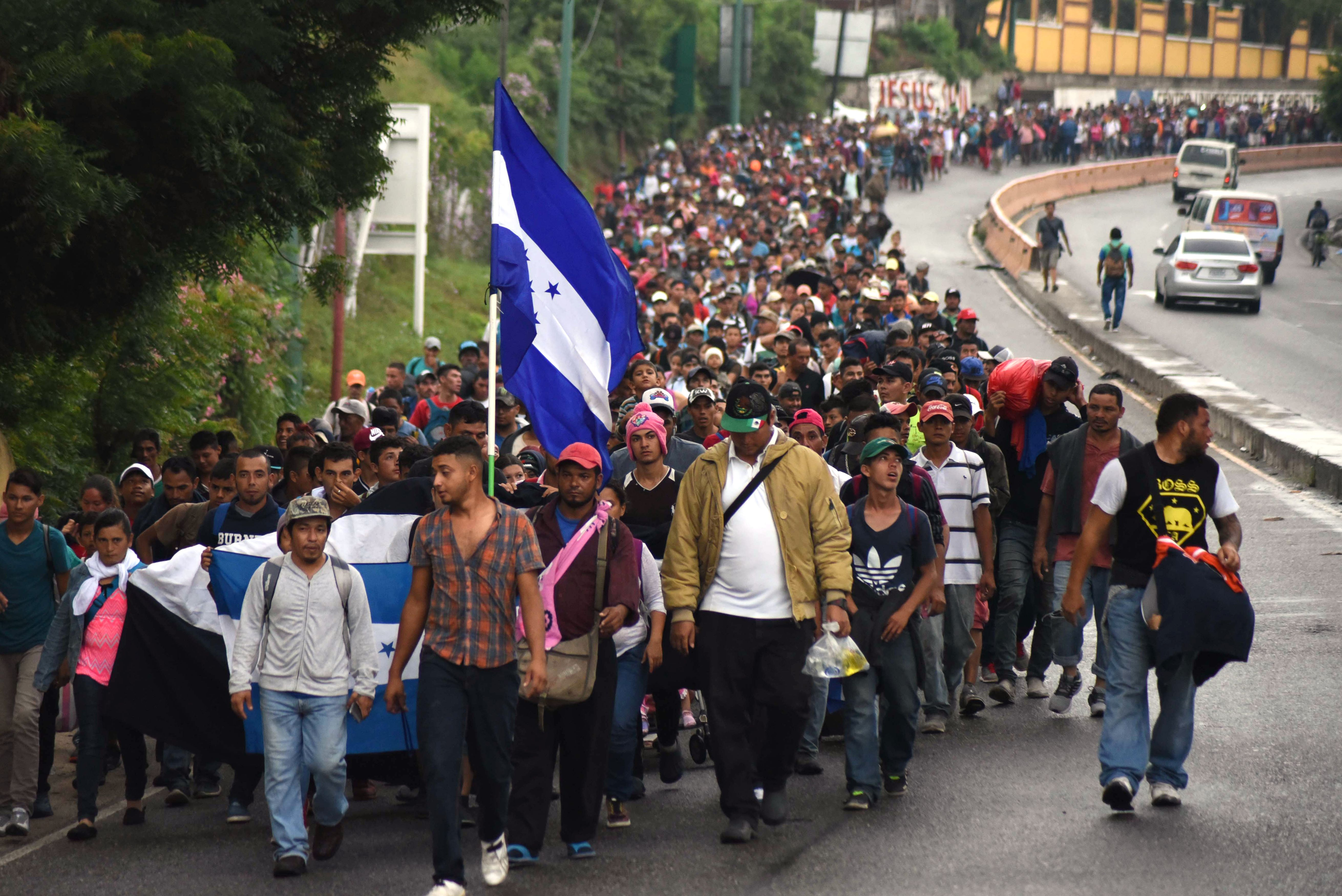 Honduran migrants take part in a caravan towards the United States in Chiquimula, Guatemala on October 17, 2018. ORLANDO ESTRADA/AFP/Getty Images