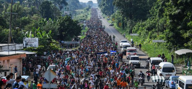Honduran migrants take part in a caravan heading to the US, on the road linking Ciudad Hidalgo and Tapachula, Chiapas state, Mexico, on October 21, 2018. - Thousands of Honduran migrants resumed their march toward the United States on Sunday from the southern Mexican city of Ciudad Hidalgo, AFP journalists at the scene said. (Photo by Pedro Pardo / AFP) (Photo credit should read PEDRO PARDO/AFP/Getty Images)