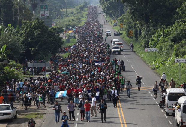 CIUDAD HIDALGO, MEXICO - OCTOBER 21: A migrant caravan, which has grown into the thousands, walks into the interior of Mexico after crossing the Guatemalan border on October 21, 2018 near Ciudad Hidalgo, Mexico The caravan of Central Americans plans to eventually reach the United States. U.S. President Donald Trump has threatened to cancel the recent trade deal with Mexico and withhold aid to Central American countries if the caravan isn't stopped before reaching the U.S. (Photo by John Moore/Getty Images)