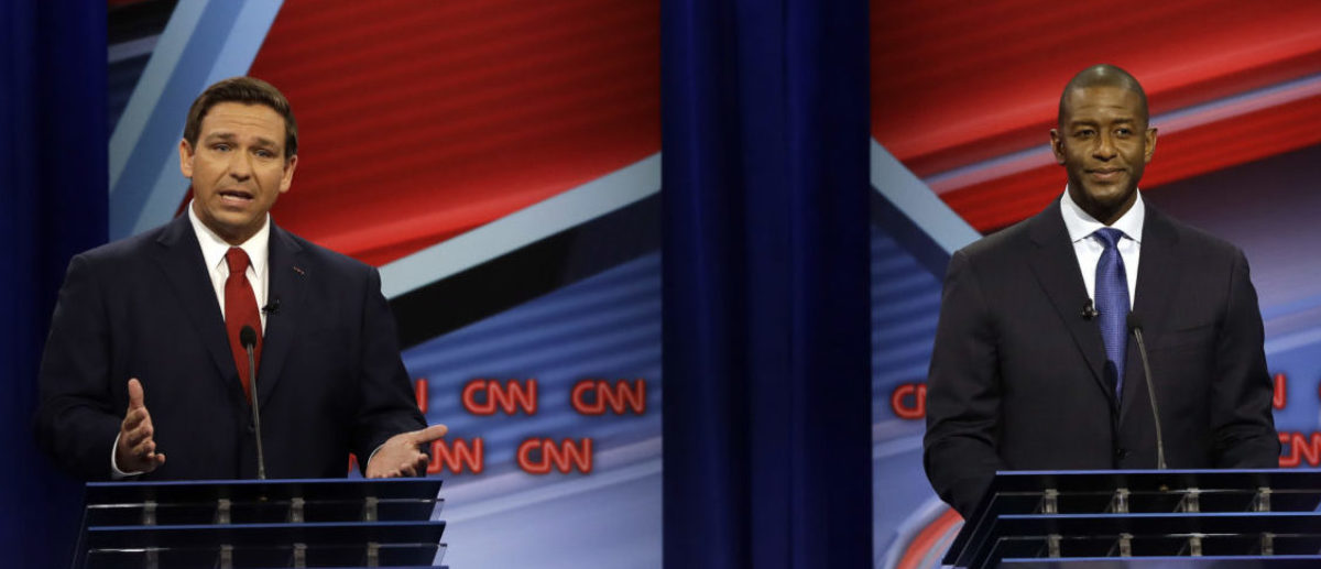 TAMPA, FLORIDA - OCTOBER 21: Florida Republican gubernatorial candidate Ron DeSantis, left, speaks about his Democratic opponent Andrew Gillum during a CNN debate, Sunday, Oct. 21, 2018, in Tampa, Fla. (Photo by Chris O'Meara-Pool/Getty Images)
