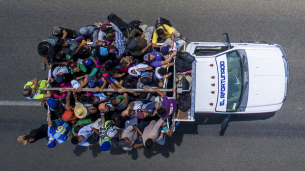 Aerial view of Honduran migrants onboard a truck as they take part in a caravan heading to the US, in the outskirts of Tapachula, on their way to Huixtla, Chiapas state, Mexico, on October 22, 2018. - President Donald Trump on Monday called the migrant caravan heading toward the US-Mexico border a national emergency, saying he has alerted the US border patrol and military. (Photo by PEDRO PARDO / AFP) (Photo credit should read PEDRO PARDO/AFP/Getty Images)