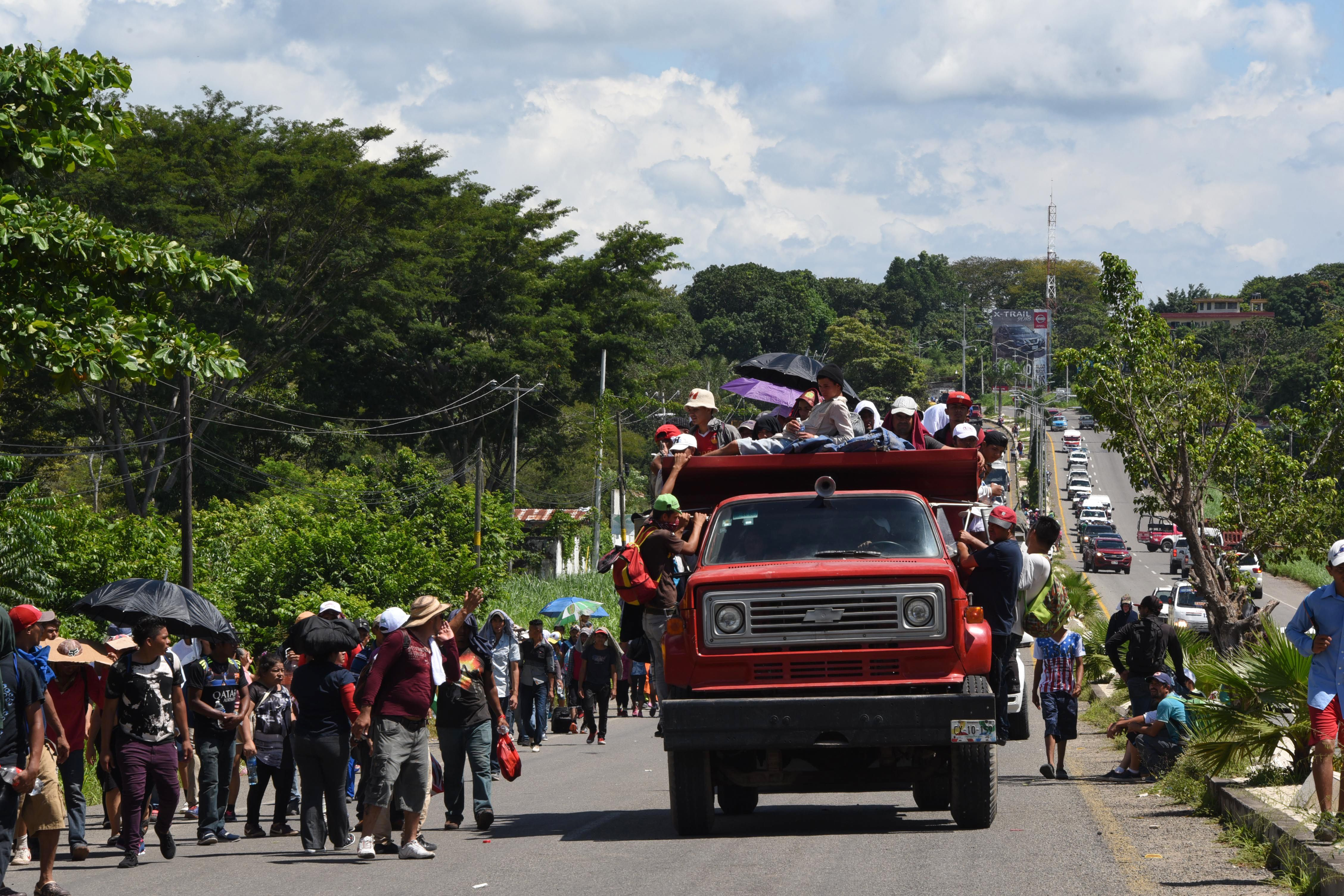 Honduran migrants take part in a caravan heading to the US, in the outskirts of Tapachula, on their way to Huixtla, Chiapas state, Mexico, on October 22, 2018. - President Donald Trump on Monday called the migrant caravan heading toward the US-Mexico border a national emergency, saying he has alerted the US border patrol and military. (Photo: JOHAN ORDONEZ/AFP/Getty Images)